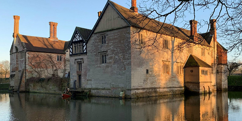 How do you feel about visiting a house with secret hiding spaces, surrounded by a moat?